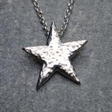 Hammered star pendant P53